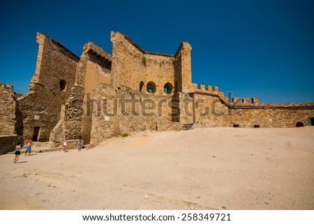 SUDAK, REPUBLIC OF CRIMEA, Ukraine- AUG 21, 2008. Ruins of The Genoa Fortress in Sudak Crimea  #258349721