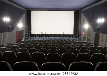 Empty cinema auditorium with line of chairs and stage with silver screen. Ready for adding your own picture. #25842982