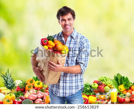 People with Vegetables over green background. Healthy diet. #258613829