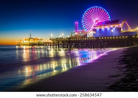 The Santa Monica Pier at night, in Santa Monica, California. Royalty-Free Stock Photo #258634547
