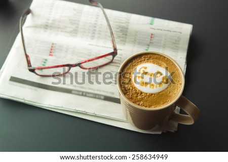 Good morning cup of coffee with newspaper