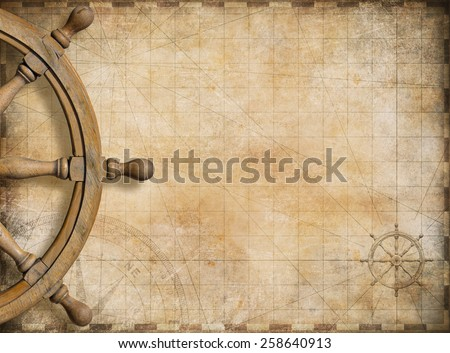 steering wheel and blank vintage nautical map background Royalty-Free Stock Photo #258640913