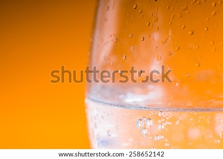 Glass of Water over orange background #258652142
