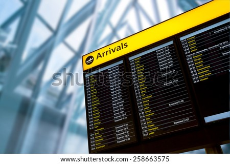 Check in, Airport Departure & Arrival information board sign Royalty-Free Stock Photo #258663575