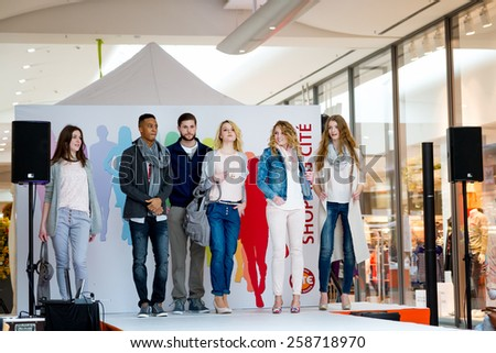 BADEN-BADEN, GERMANY - MARCH 7: Fashion model wearing clothes from the spring collection in a shopping center   on March 7, 2015 in Baden-Baden. Germany. Europe. #258718970