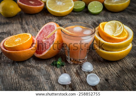Ripe grapefruit with juice on table  #258852755