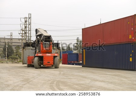 forklift handling the container box #258953876