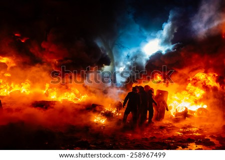 Protesters walk on fire