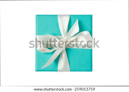 Top view of turquoise isolated gift box with white ribbon on white background #259013759