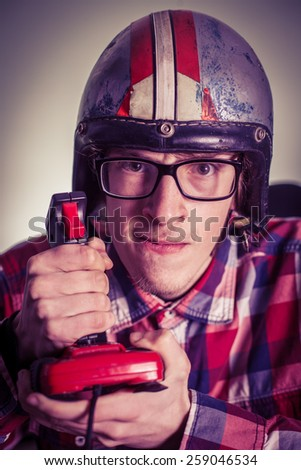 Young nerd playing video games on retro joystick #259046534
