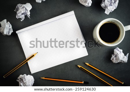 Top View of Creative Writing Concept With Pencils, Coffee Cup, Notepad and Crumpled Paper on Table.