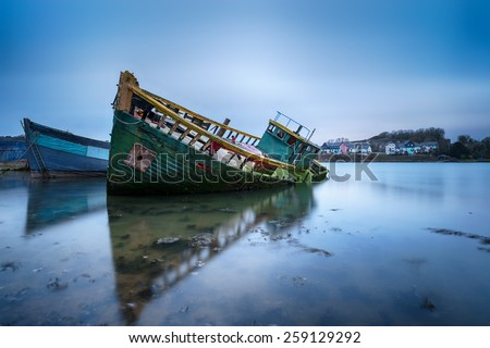 Old boats in their final resting place at Hooe Lake in Plymouth, Devon Royalty-Free Stock Photo #259129292