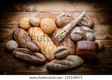 fresh bread  and wheat on the wooden #259148471
