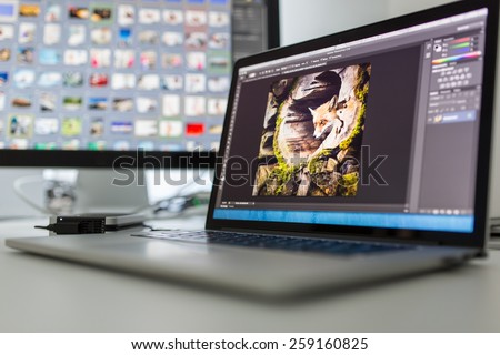 Photographers computer with photo edit apps/programs running