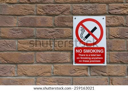 No Smoking Sign on Orange Brick Wall