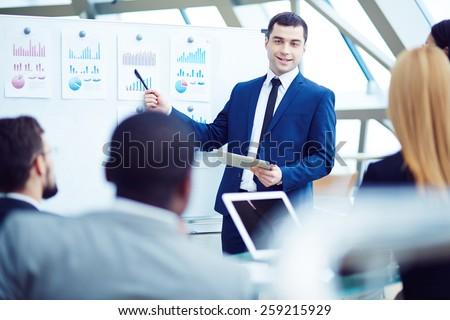 CEO explaining his plan Royalty-Free Stock Photo #259215929