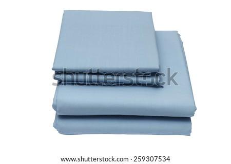 Folded bed linen or duvet cover on white isolated background #259307534