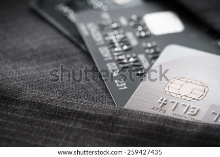 Credit cards in very shallow focus  with gray suit background