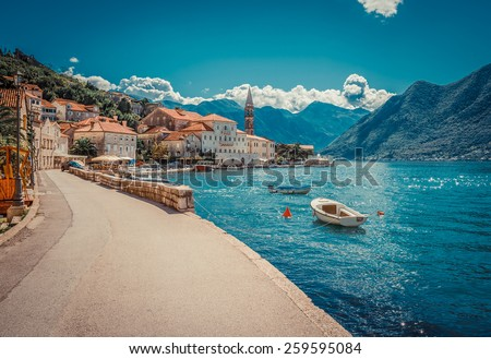 Harbour and boats in sunny day at Boka Kotor bay (Boka Kotorska), Montenegro, Europe. Retro toned image. Royalty-Free Stock Photo #259595084