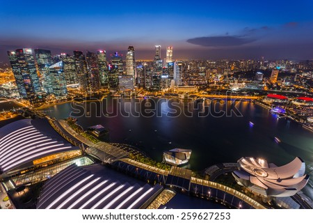 SINGAPORE - FEBRUARY 27, 2015: aerial view of sunset scene of Marina Bay. Marina Bay is one of the most famous tourist attraction in Singapore.  #259627253