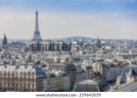 Blurred background: panorama of Paris from Cathedral Notre Dame de Paris. France.