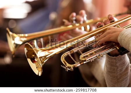 Pipes in the hands of musicians Royalty-Free Stock Photo #259817708