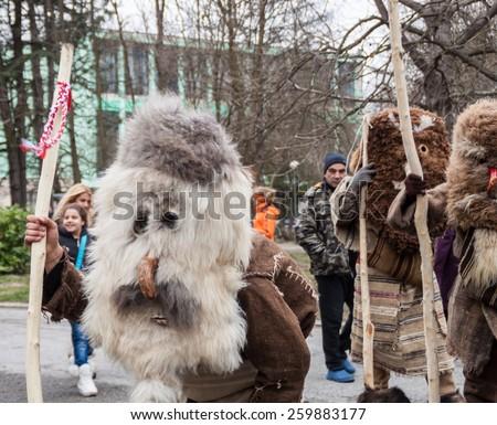 YAMBOL, BULGARIA - MARCH 08, 2015 - Kukerlandia - mask festival and masquerade games 08 March 2015. Bulgarian traditional dances and costumes called Kukeri. #259883177