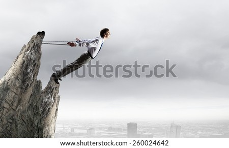 Young emotional office businessman tied with rope #260024642