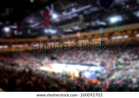 blurred background of basketball crowd in arena                              #260092703
