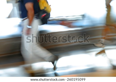 blurred image of passengers in transit at an airport #260195099