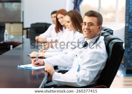 Medical workers working in conference room #260377415