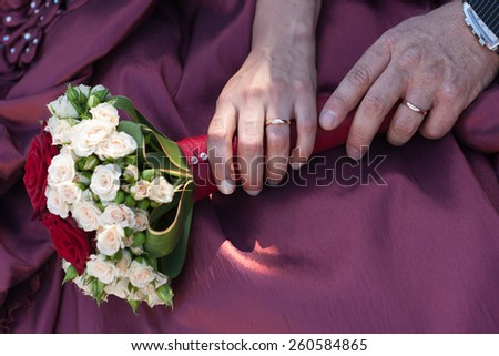 Hands, rings and bouquet #260584865