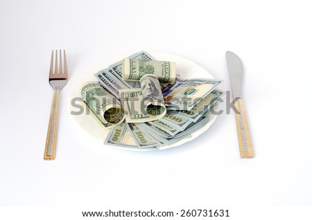 money with dollar currency cutlery on a plate fork knife on a white background