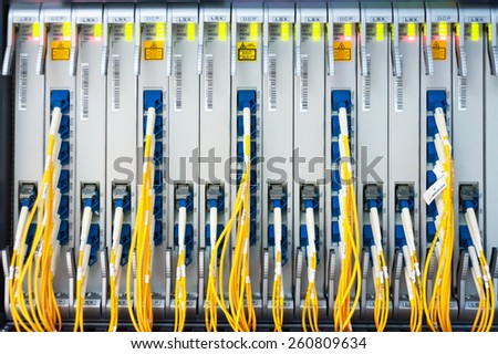 fiber optic with servers in a technology data center . #260809634