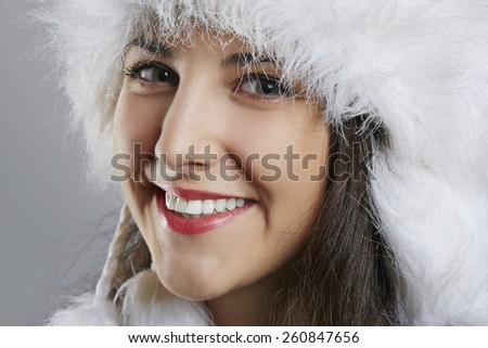 Joyful young woman in winter wear #260847656