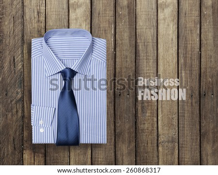 blue shirt on a wooden brown background #260868317