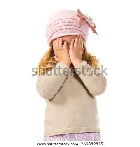 Blonde kid covering her eyes #260889815