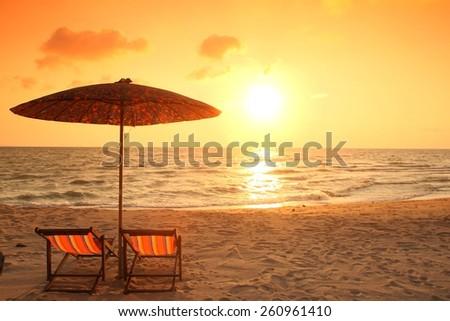 beach chair on the beach with sunset #260961410