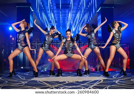 dance group sexy girls in suits, disco,