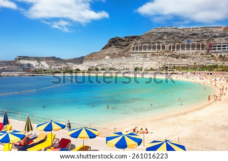 Playa de Amadores beach near Puerto Rico town. Gran Canaria, Canary Islands. Spain Royalty-Free Stock Photo #261016223