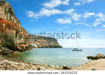Seascape of coast of Puerto de Mogan. Gran Canaria. Canary Islands.  Royalty-Free Stock Photo #261016232