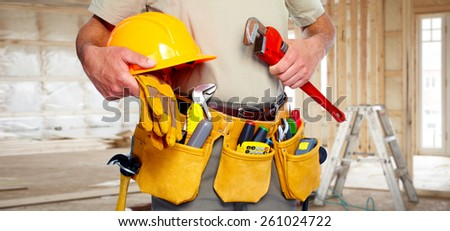 Builder handyman with construction tools. House renovation background. #261024722