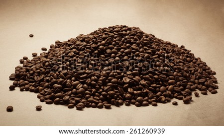Coffee beans on paper background. Paper texture coffee. Dark coffee roasted. Coffee beans #261260939
