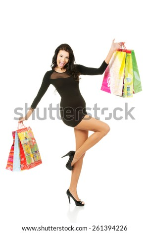 Full length woman with a lot of shopping bags. #261394226