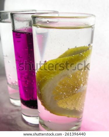 macro lemon with bubbles and back lighting #261396440