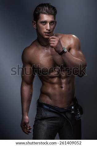Strong muscular handsome man posing in studio naked. #261409052