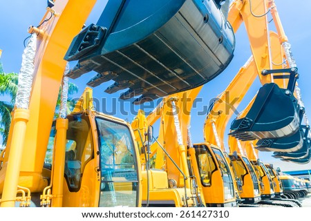 Asian Vehicle fleet with construction machinery of building or mining company Royalty-Free Stock Photo #261427310
