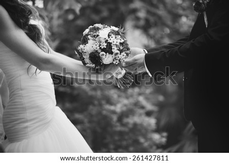 Bridal couple in love, wedding on summer day.  Picture in black and white.