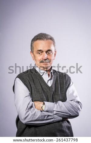 Old man in the studio looking down  #261437798