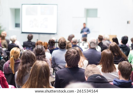 Speaker Giving a Talk at Business Meeting. Audience in the conference hall. Business and Entrepreneurship. Copy space on white board. Royalty-Free Stock Photo #261534164